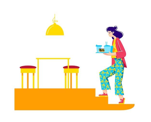 Donna che tiene il vassoio con fast food e bevande andando a tavola nella caffetteria per il pranzo