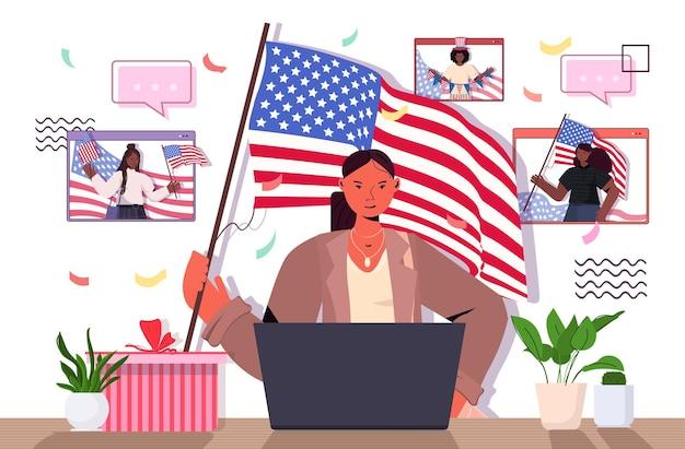Donna che tiene in mano la bandiera degli stati uniti che celebra, il 4 luglio giorno dell'indipendenza americanaamerican