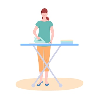 La donna la casalinga stira i vestiti, isolati su bianco. il concetto di casa, famiglia, vita.