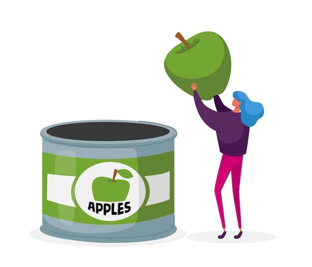 Donna che controlla la mela verde prima di metterla nel barattolo di latta