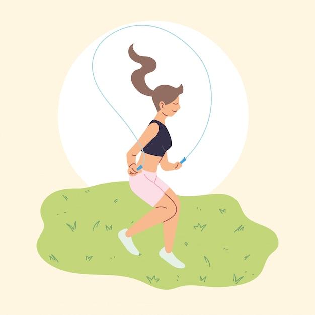 La donna sta saltando la corda, attività all'aperto