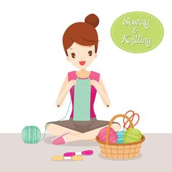 Sciarpa di lavoro a maglia della donna, strumenti di ricamo e accessori