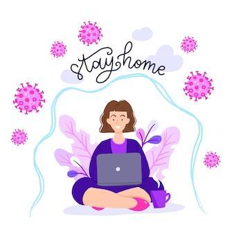 Donna nella posa del loto che lavora al suo computer portatile