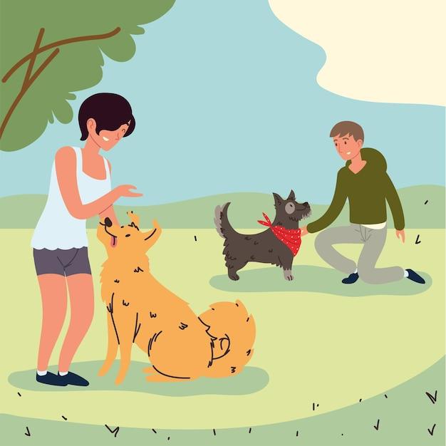 Donna e uomo con cani