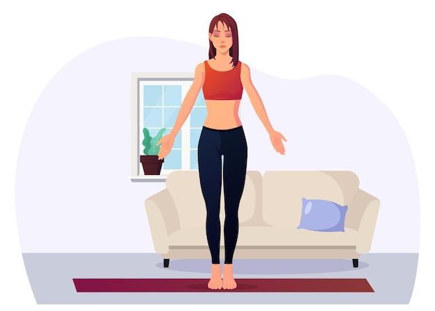 Donna che medita a casa in posizione yoga