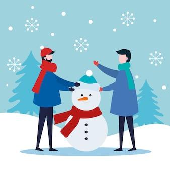 Donna e uomini con pupazzo di neve