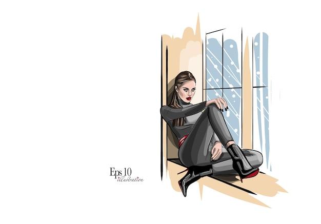 Donna vicino alla finestra