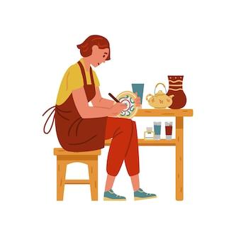 Donna che dipinge personaggio femminile artigianale piatto in ceramica fatto a mano