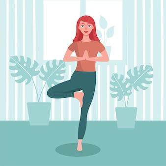 La donna pratica lo yoga a casa. concetto di sport domestico, allenamento yoga online al chiuso.