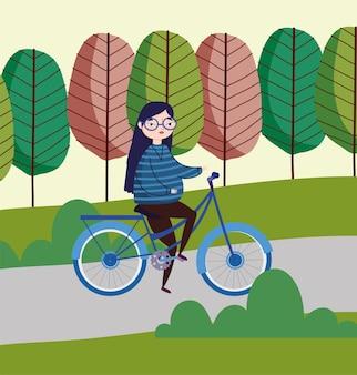 Bicicletta di guida della donna