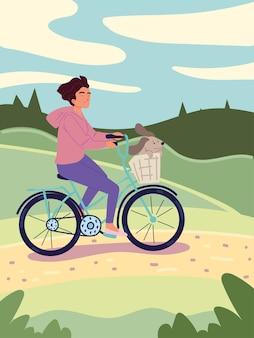 Donna in sella alla bici nel campo