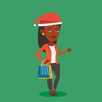 Donna nell'acquisto del cappello della santa per i regali di natale.