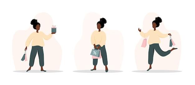 Acquisto della donna. ragazza africana felice che trasporta borse