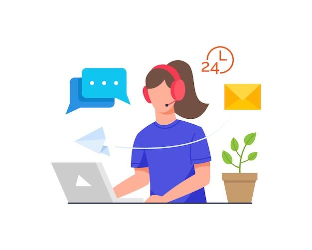 Donna che si siede allo scrittorio con la cuffia avricolare davanti al computer portatile