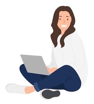 Donna seduta sul pavimento e utilizzando laptop con le gambe incrociate