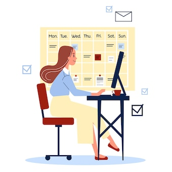 Donna in un vestito che si siede alla scrivania e lavora