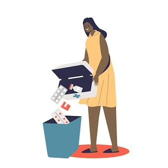Donna che getta via medicinali scaduti, pillola, farmaci e antidolorifici nel cestino. assistenza sanitaria, farmacia sicura e concetto di trattamento
