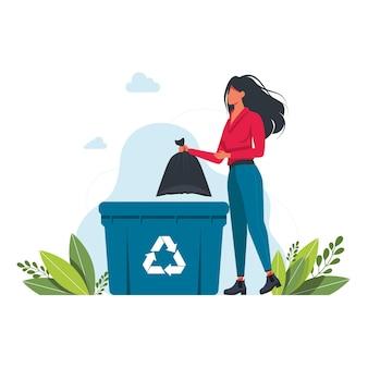 Una donna getta un sacco della spazzatura in un bidone della spazzatura, segno di riciclaggio dei rifiuti volontariato, ecologia, concetto di ambiente. la ragazza getta la spazzatura nell'illustrazione di spazzatura bin.vector. concetto di pianeta pulito
