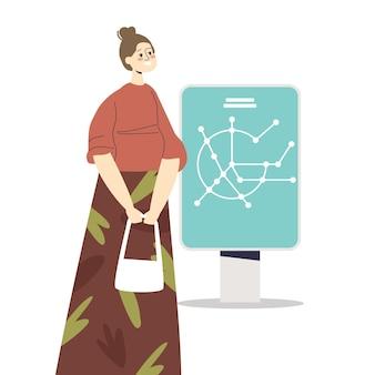 Passeggero sotterraneo donna guarda la mappa del sistema della metropolitana sulla piattaforma alla ricerca del percorso della stazione della metropolitana