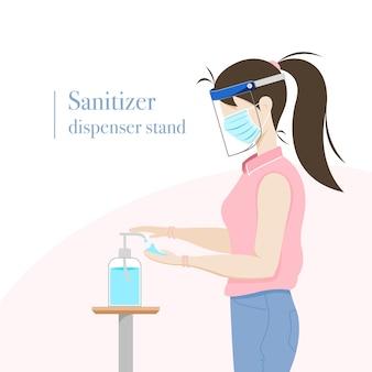 Donna che utilizza disinfettante per le mani