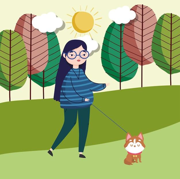 Donna che cammina con il cane