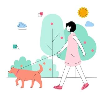 Donna che cammina con il suo cane in primavera