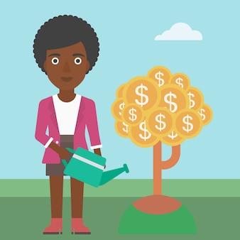 Albero dei soldi d'innaffiatura della donna