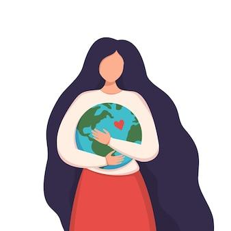 Una donna con lunghi capelli scuri abbraccia la terra. prenditi cura del nostro pianeta.