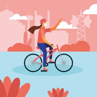 Donna con mascherina medica sulla bici