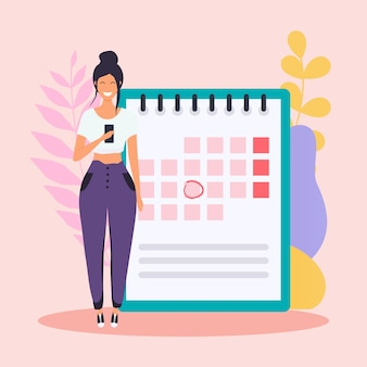 La donna con il telefono ha un piano di calendario.