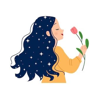 Donna con capelli lunghi setosi che tiene un fiore