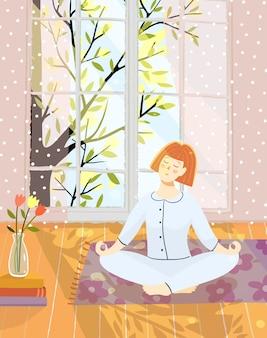 Donna o giovane ragazza meditando facendo yoga a casa in camera con la natura nella grande finestra.