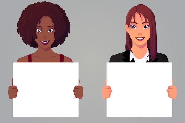 Donne che tengono un foglio di carta bianco