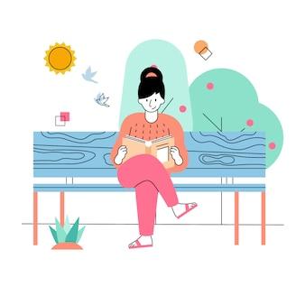 Le donne leggono libri nel parco in primavera
