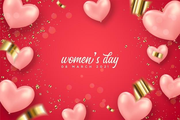 Giornata della donna con palloncini rosa amore e spruzzi d'oro su sfondo rosso.