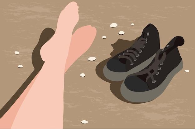 I piedi delle donne sulla spiaggia. scarpe da ginnastica sulla sabbia.