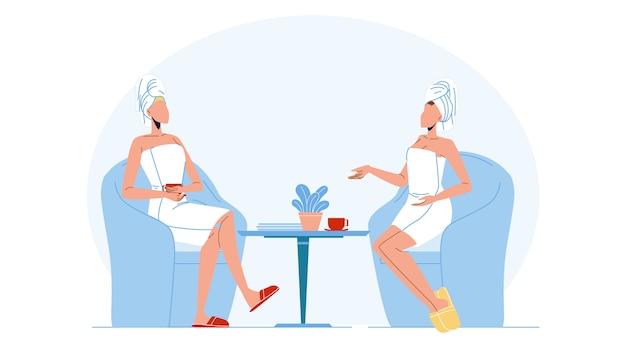 Donne che indossano accappatoio e asciugamano sulla testa