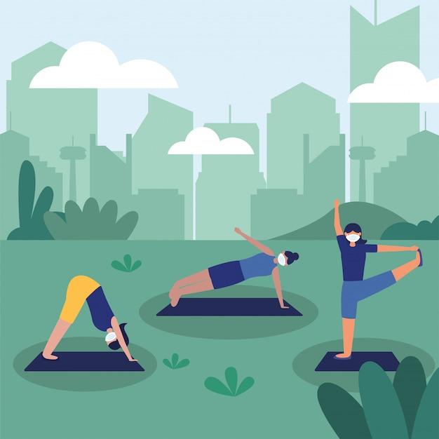 Donne con le maschere che fanno yoga al parco Vettore Premium