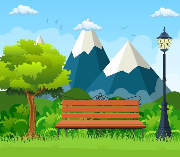Panca in legno, lampione nel parco, cespugli e montagne.