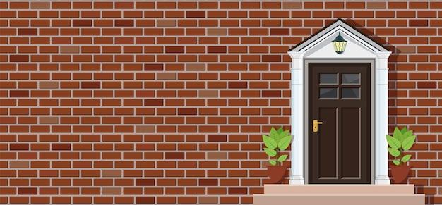 Porta di legno della vista frontale della casa con mattoni a vista, fondo di architettura,