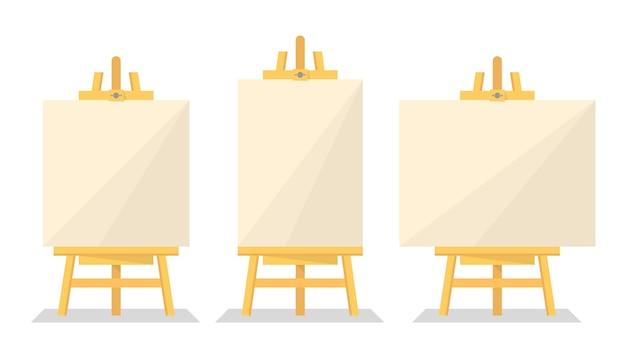 Cavalletto in legno impostato isolato. bordo di carta bianco. manifesto vuoto per l'annuncio. display creativo.