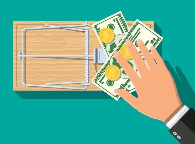 Trappola per topi in legno con banconote in dollari e monete d'oro