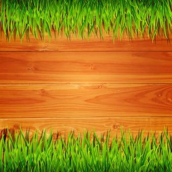 Tavole di legno con sfondo di erba verde