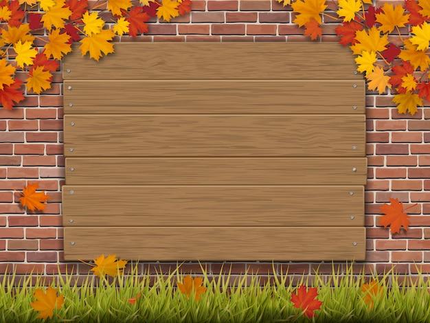 Cartello in legno sui rami di acero autunno muro di mattoni