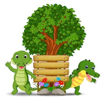 Modello di cartello in legno con due coccodrilli