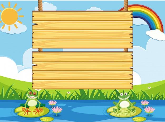 Modello di cartello in legno con due frogns nello stagno