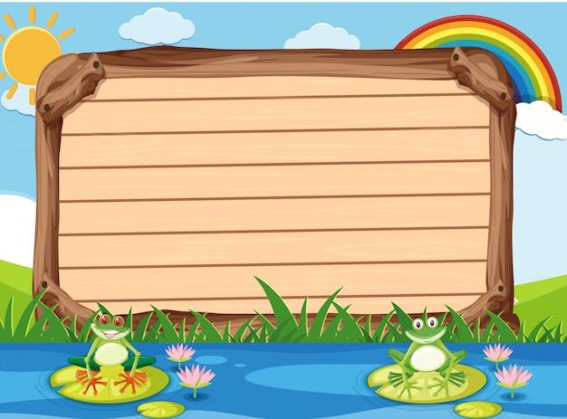 Modello di cartello in legno con due rane nel parco