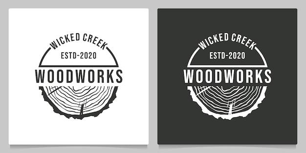 Fetta di legno lavorazione del legno vintage retrò logo design all'aperto