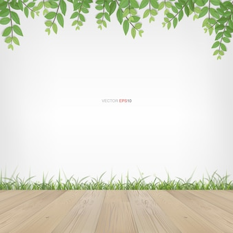 Terrazza in legno con cornice di foglie verdi e area naturale verde. con area bianca per lo spazio della copia. illustrazione vettoriale.