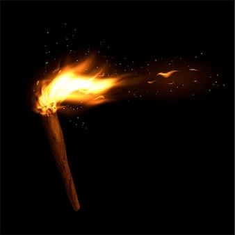 Una torcia di legno con un fuoco ardente. fiamma e scintille luminose.